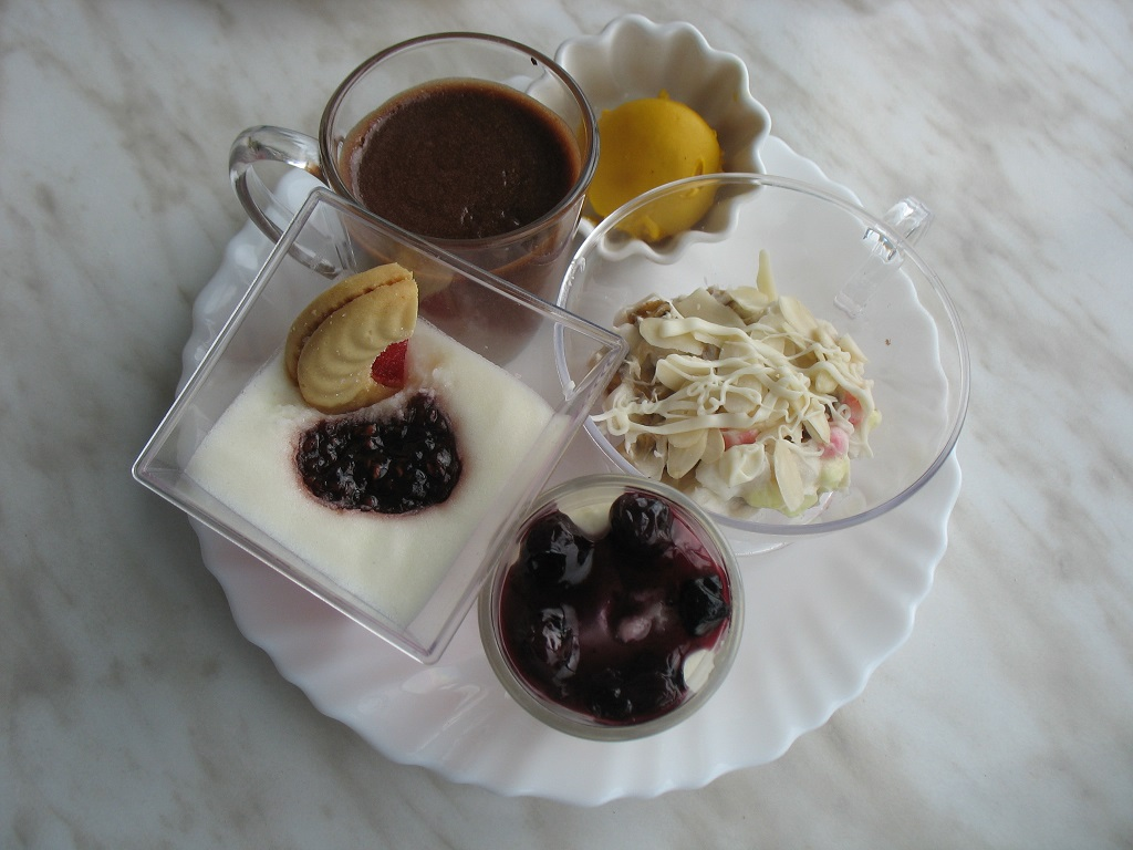 Dessert cups with nuts, chocolates and fruit preserves